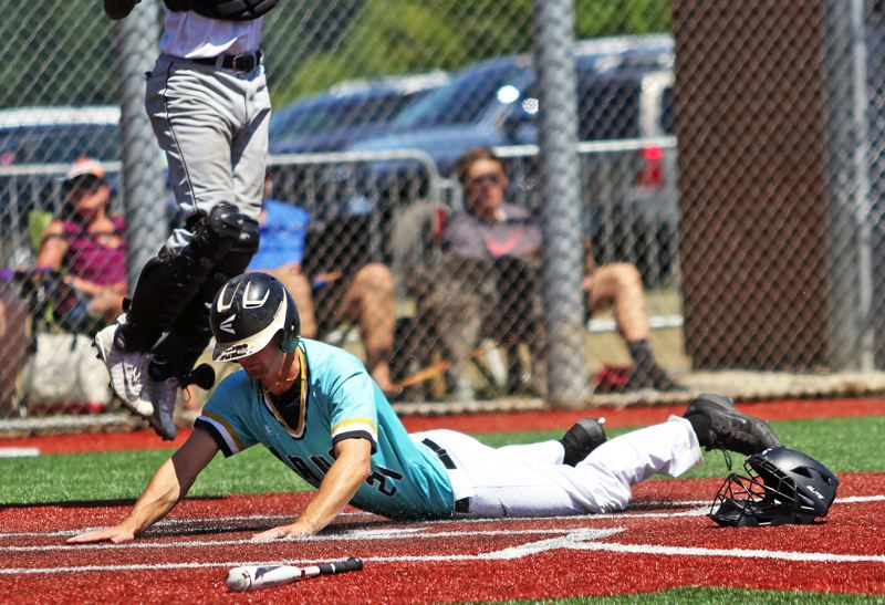 PMG PHOTO: DAN BROOD - Tualatin's Blake Jackson slides home safely for the Dawgs' third run in their 3-2 victory over Oregon City in Friday's quarterfinal game at the OIBA National tournament.