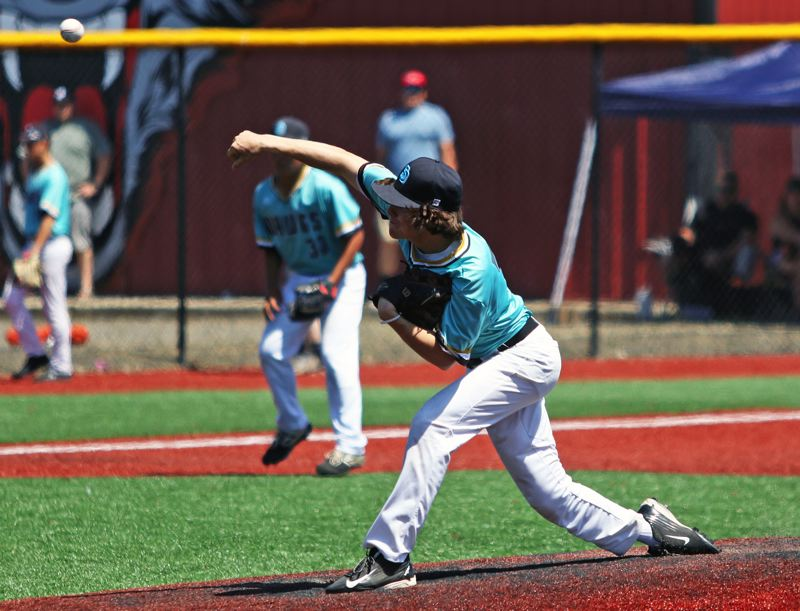 PMG PHOTO: DAN BROOD - Tualatin's Joey Myers unleashes a pitch during the Dawgs' 3-2 win over Oregon City in Friday's quarterfinal game at the OIBA National tournment.