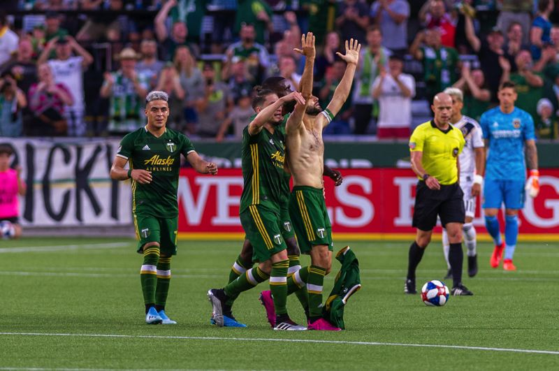 COURTESY PHOTO: DIEGO G. DIAZ - Diego Valeri removes his shirt after scoring in the Portland Timbers' 4-0 victory over the Los Angeles Galaxy.