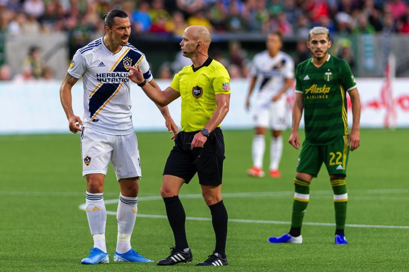 COURTESY PHOTO: DIEGO G. DIAZ - Zlatan Ibrahimovic (left) states his case as the Los Angeles Galaxy fall 4-0 to the Portland Timbers.