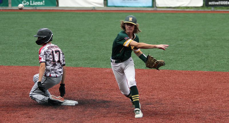 PMG PHOTO: MILES VANCE - West Linn shortstop Tyson Smith turns a double play during his team's 8-0 win over Portland Babe Ruth in the semifinals of the 14U Babe Ruth Pacific Northwest regional tournament at West Linn High School on Saturday, July 27.