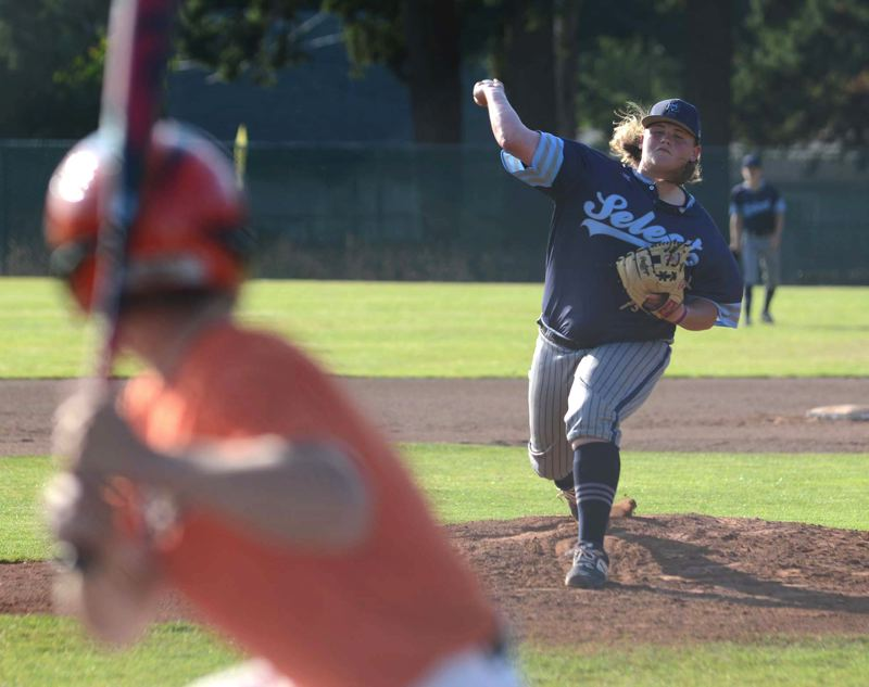 PMG PHOTO: DAVID BALL - Mt. Hood Select starter Elijah Heacock delivers a throw to the plate. He struck out three batters in the teams 11-2 win over Scappoose on Friday.