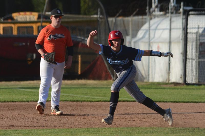 PMG PHOTO: DAVID BALL - Mt. Hoods Coleman Landolt gets a jump off first base.