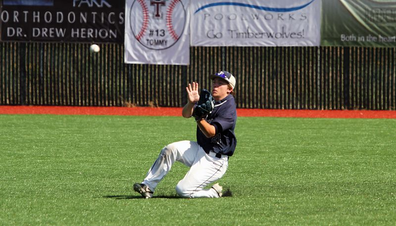 PMG PHOTO: MILES VANCE - Lake Oswego right fielder Charlie Owens makes a sliding catch during his team's 10-1 win over West Linn in the OIBA's National League Tournament at Tualatin High School on Friday, July 26.