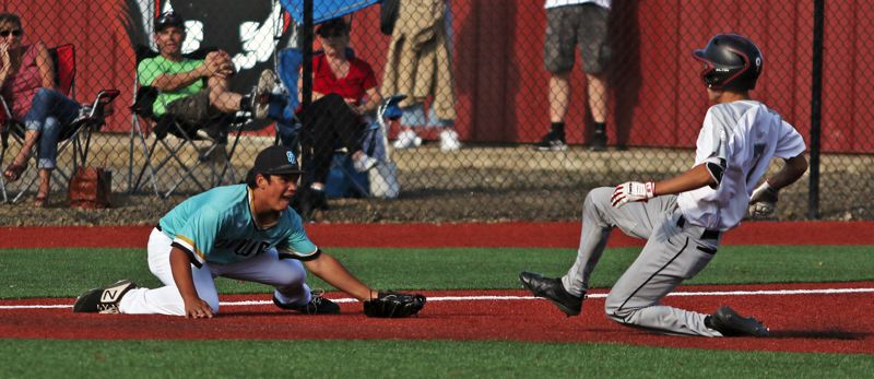 PMG PHOTO: DAN BROOD - Tualatin third baseman Shawn Hunt (left) gets ready to tag out Clackamas' Brody Upton during Saturday's OIBA National tournament championship game.