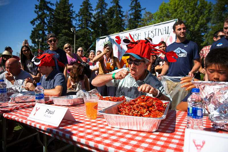 TIMES FILE PHOTO - Participants in the annual Crawfish Festival contest vie to become the reigning champ of the event, which attracts thousands to Tualatin Community Park.