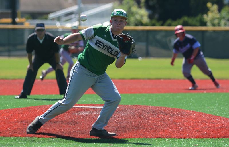 PMG PHOTO: DAVID BALL - Reynolds pitcher Drexler Dickey prepares to glove a hopper on the mound for the final out in the Raiders 5-4 comeback win over Mt. Hood Select on Thursday.