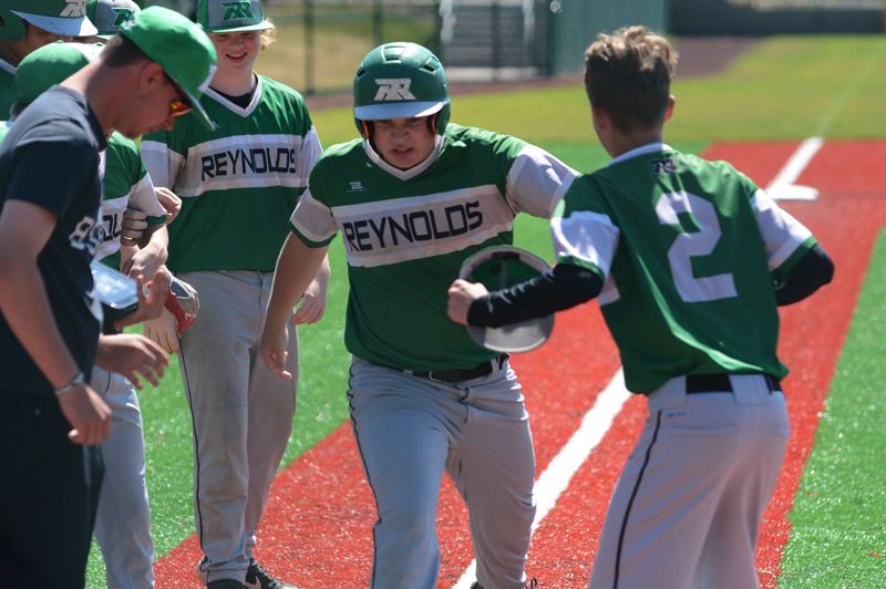 PMG PHOTO: DAVID BALL - Reynolds Drexler Dickey is greeted at home plate after hitting the go-ahead two-run homer in the top of the seventh inning to lift the Raiders past Mt. Hood Select 5-4 on Thursday.