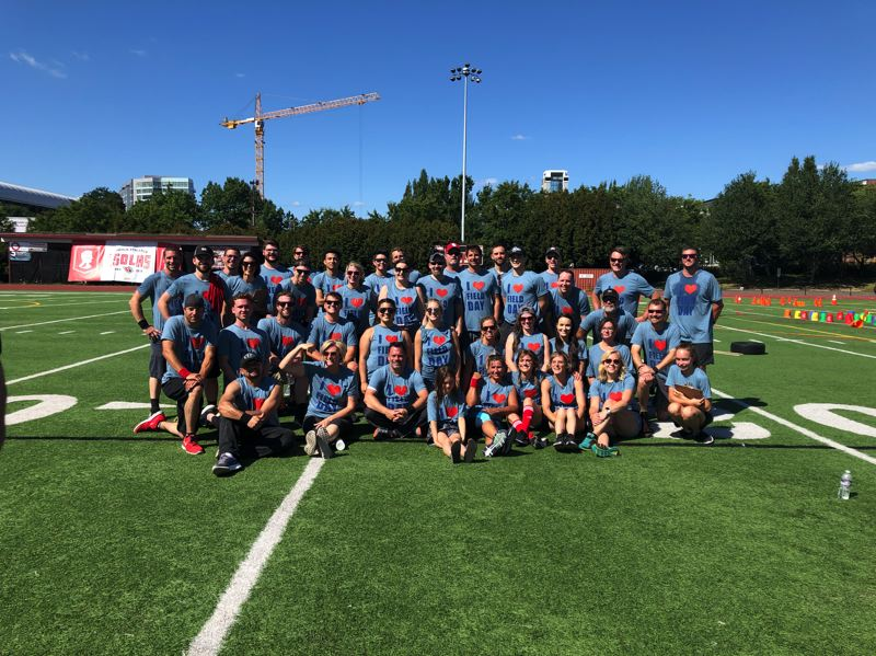 COURTESY: R&H CONSTRUCTION - Forty-five R&H Construction employees took part in the companys 2019 Field Day event, held July 19 at the Lincoln High School in Portland.