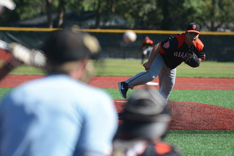 PMG PHOTO: DAVID BALL - Sandy reliever Christian Olmos follows through on a throw to the plate.