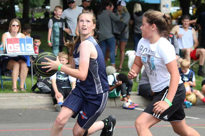 PMG PHOTO: DEREK WILEY - Wilsonville's Grace Wilson drives to the basket during the Canby Rotary Nothing-But-Net 3-on-3 basketball tournament Saturday at Wait Park.
