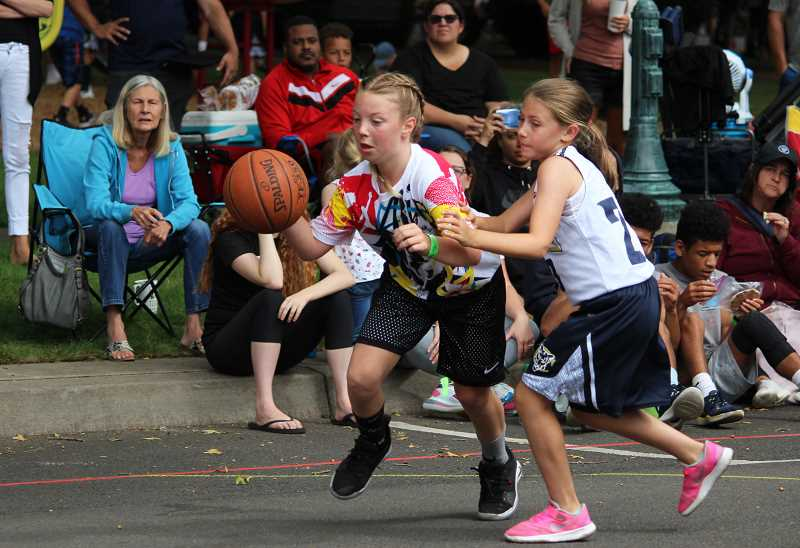 PMG PHOTO: DEREK WILEY - Canby's Kallie White drives to the goal Saturday at a 3-on-3 basketball tournament at Wait Park.
