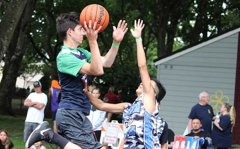PMG PHOTO: DEREK WILEY - Colton's Dominic Combest puts up a shot at the Canby Rotary 3-on-3 basketball tournament Saturday at Wait Park.