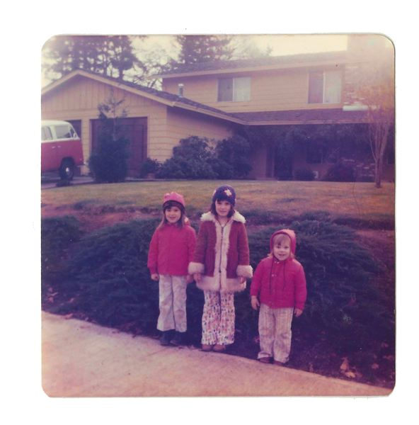 COURTESY PHOTO - In this photo taken in 1976, three out of the five Mundorff kids are in front of their parents' Oak Grove home (from left) Lisa, Amy and Emily.