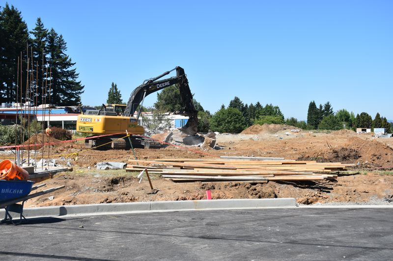 PMG PHOTO: TERESA CARSON - As workers finish the demolition of the North Stars old home, heavy equipment has moved in to ready the ground for playgrounds, ball fields and parking lots.