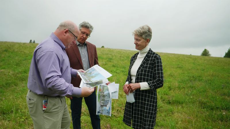 COURTESY PHOTO: CITY OF GRESHAM.  - Eric Schmidt, Gresham's community develoment Director, David Berniker, Greshams urban design and planning director and Metro Councilor Shirley Craddick look over the plans for Alta Civic Station on the site of the new development