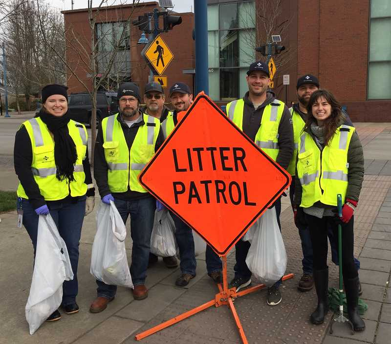 SUBMITTED PHOTO - Employess of NW Natural Gas are part of an Adopt-a-Road program and clean up Railroad Street four times each year for a minimum of two years.
