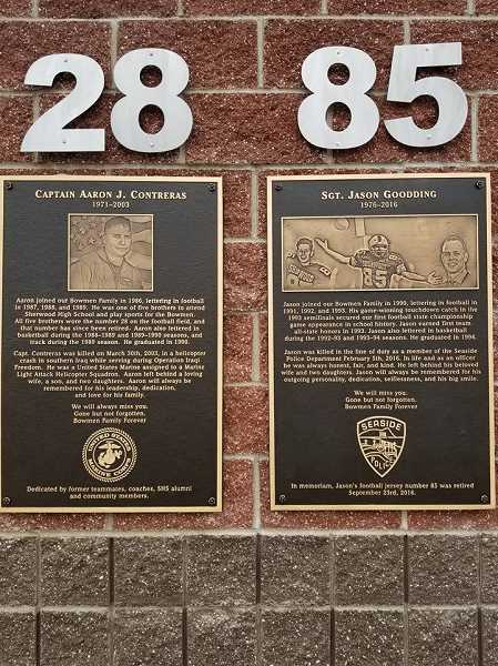 SUBMITTED PHOTO - These two plaques, which honor two Sherwood High School graduates who loss their lives, are installed at the athletic field at Sherwood High School.