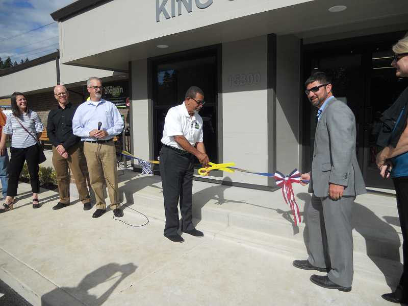 COURIER PHOTO: SCOTT KEITH - King City Mayor Ken Gibson cuts the ribbon at the newly remodeled King City Hall on June 19.
