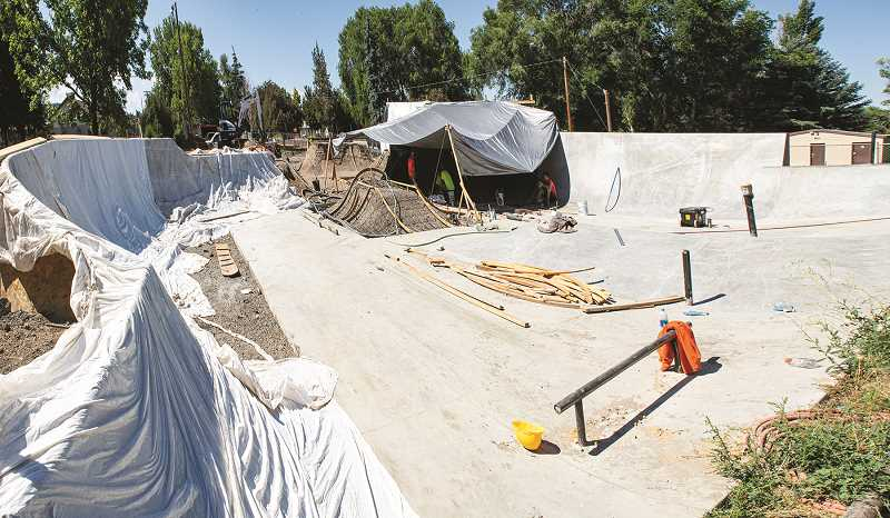 LON AUSTIN - Many of the ramps and bowls had to be built up with dirt piles, which were compacted and then dug back out.