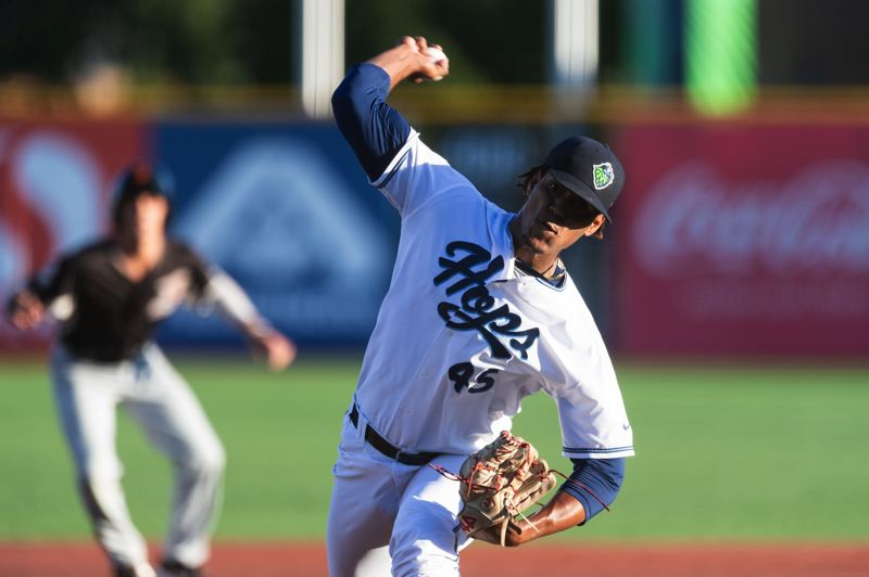 PMG PHOTO: CHRISTOPHER OERTELL - Hillsboro Hops starter Luis Frias throws a pitch against the Salem-Keizer Volcanoes on Thursday, July 25, at Ron Tonkin Field.