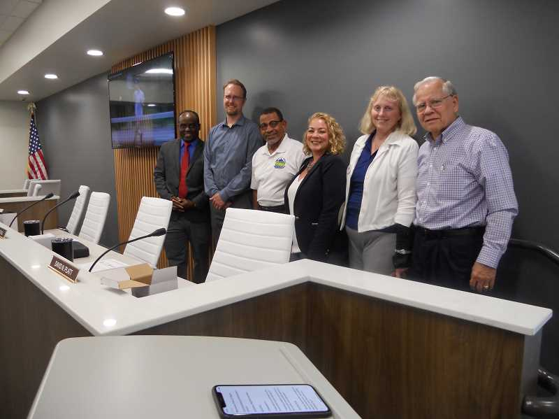 COURIER PHOTO: SCOTT KEITH - King City Council members dedicated a remodeled City Hall on June 19. They include, from left, Smart Ocholi, Micah Paulsen, Mayor Ken Gibson, Jaimie Fender, Gretchen Buehner and David Platt. Not pictured is Councilor John Boylston.