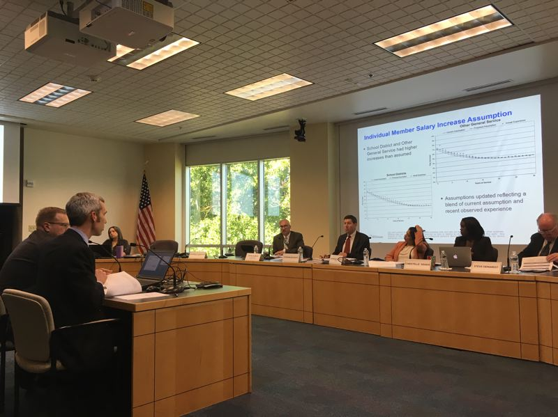 PMG PHOTO BY PETER WONG - Matt Larrabee, left, and Scott Preppernau of Milliman consulting firm brief the Oregon Public Employees Retirement System board on Friday, July 26, before a board vote on the assumed rate of return on investment earnings for the 2021-23 state budget cycle.