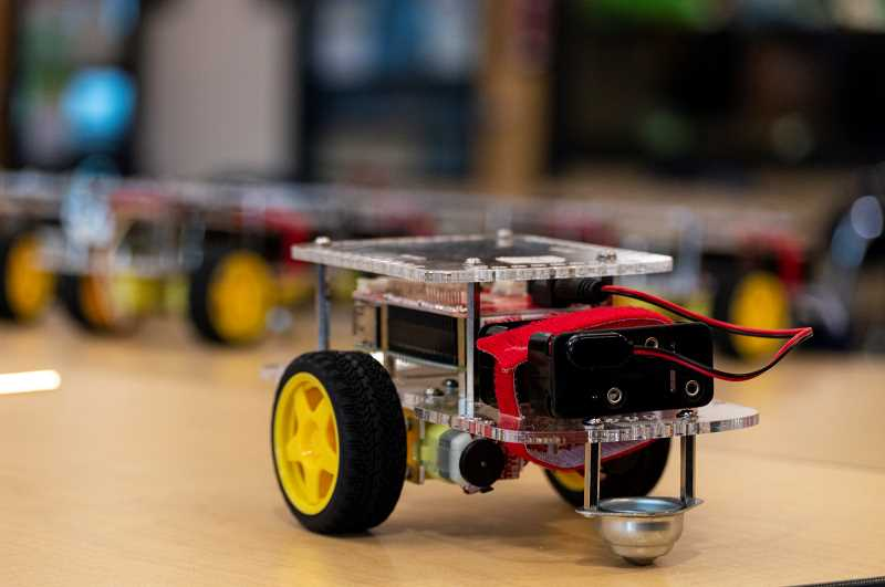 PMG PHOTO: CLARA HOWELL - Campers learn how to code these mini FIRST Robotics Competition bots.