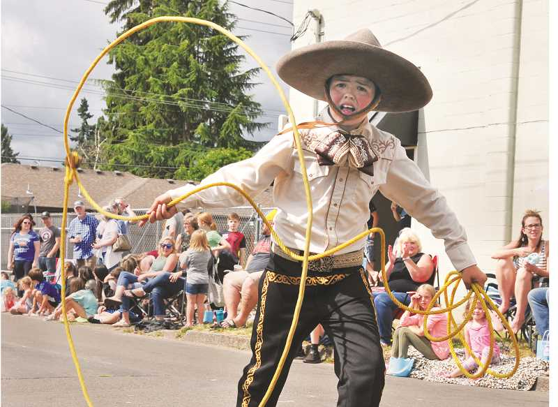 GRAPHIC PHOTO: GARY ALLEN - Plenty of young performers walked the parade route, among them an expert with the lasso.