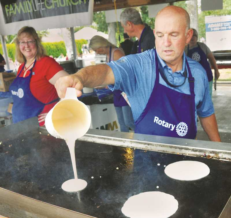 GRAPHIC PHOTO: GARY ALLEN - Randy Morgan, a member of Early Bird Rotary Club, conjured up some fine flapjacks at the pancake breakfast on Saturday.