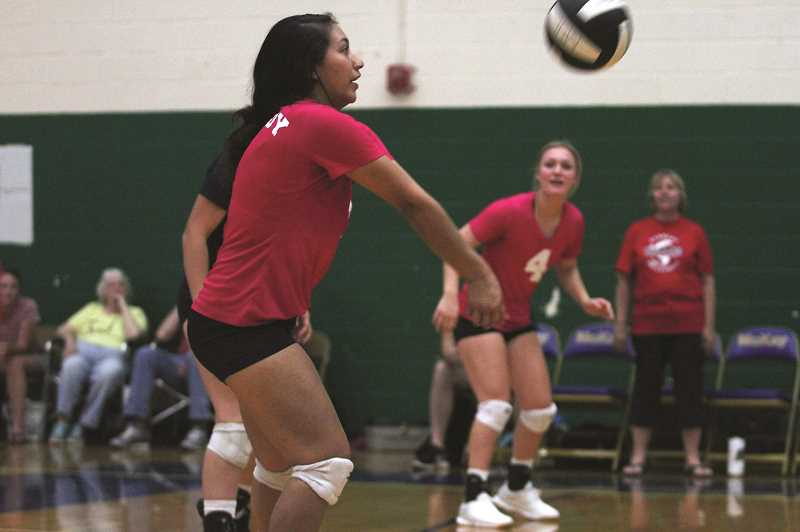 PMG PHOTO: PHIL HAWKINS - Senior Ibeth Gomez gives the Trojans a dependable back line defender and setter.
