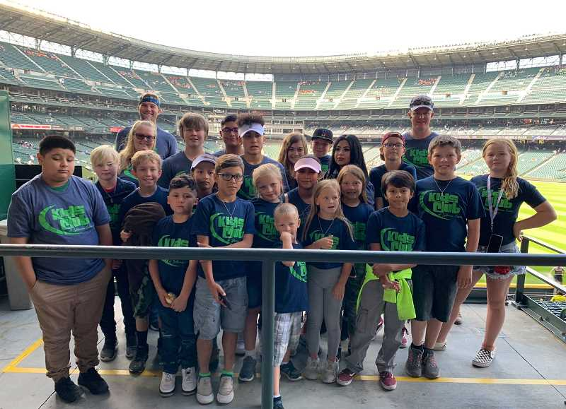 SUBMITTED PHOTO - The Kids Club of Jefferson County traveled to Seattle to watch the Mariners July 24. It was Kids Night at the T-Mobile Stadium and youngsters were able to walk around the warning track on the field, watching the Mariners and Texas Rangers warm up. The Mariners were able to beat the Rangers 5-3 and Kids Club was shown on the jumbotron on the big screen.