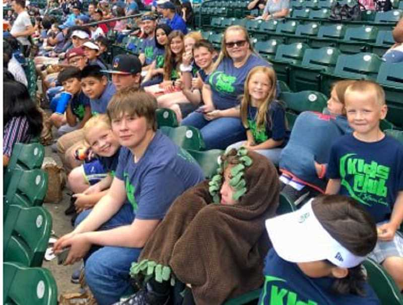SUBMITTED PHOTO - The Kids Club of Jefferson County take their seats, watching the Mariners defeat the Rangers 5-3 July 24.