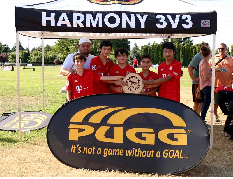 SUBMITTED PHOTO - Jacob Turo, Steve Gonzalez, Cruz Bocanegra, Osvaldo Castaneda, Eben Tapia and coach Ramon Castaneda were on a Madras 14-and-under soccer team that took first place in the Harmony 3v3 Challenge 2019 soccer tournament in Vancouver, Washington, July 27.