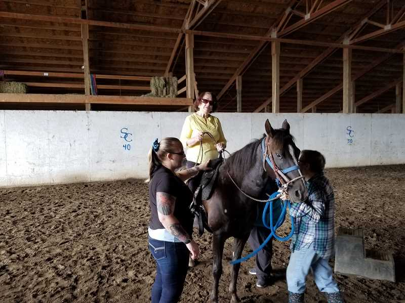 COURTESY PHOTO - Lucia Martinez-Osorio grew up riding horses in her native Colombia. Now 92, the Beaverton resident asked her hospice nurses to help her ride a horse one last time.