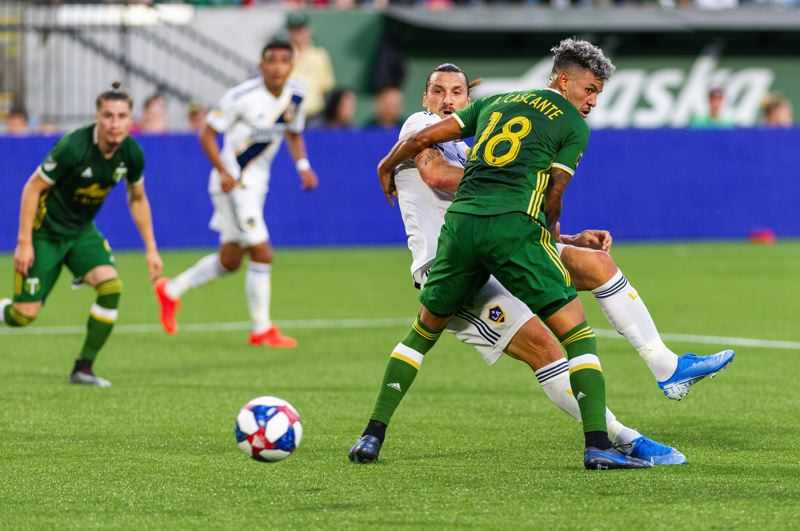 COURTESY PHOTO: DIEGO G. DIAZ - Portland Timbers defender Julio Cascante gets physical with Zlatan Ibrahimovic, star striker of the Los Angeles Galaxy, which lost 4-0 at Providence Park on Saturday.