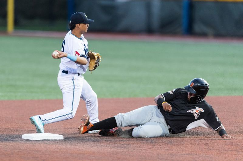 PMG PHOTO: CHRISTOPHER OERTELL - Hillsboro Hops infielder Steven Leyton makes a play at second base during a Northwest League game at Ron Tonkin Field.