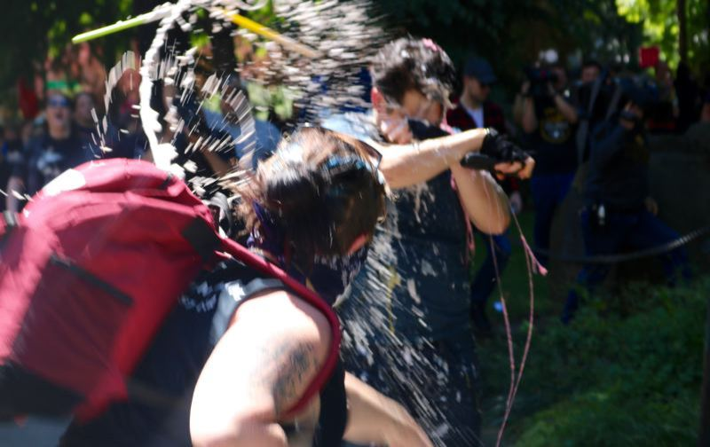 PMG FILE PHOTO - A left-wing counter-protester hurls water at conservative reporter and commentator Andy Ngo while he was being assaulted.