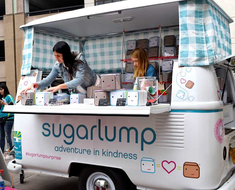 Nicole Selis and her daughter Stella arrange merchandise inside the Sugarlump Dub Box.