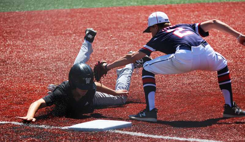 PMG PHOTO: DEREK WILEY - Wilsonville junior Shane Tacla, playing for NW Star Academy this summer, slides head first to avoid the tag at third base.