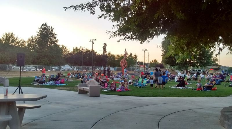 COURTESY PHOTO: JEFF WEISS, SCAPPOOSE PUBLIC LIBRARY DISTRICT - Kids and adults gather for a movie in Heritage Park last year. After the completion of Heritage Park in fall 2017, Scappoose Public Library Director Jeff Weiss saw an opportunity to host more events for the community.