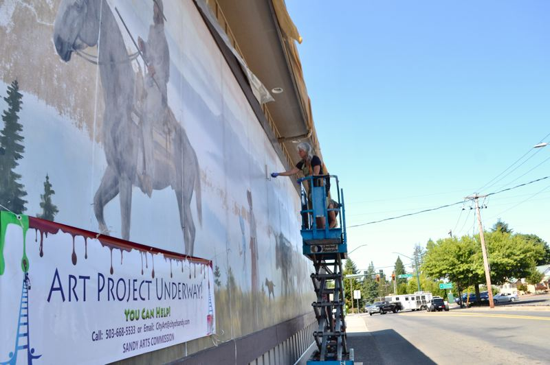 PMG PHOTO: BRITTANY ALLEN - The 'Peaceful Vistas' mural on ACE Hardware has become a top priority for restoration by the Sandy Arts Commission.