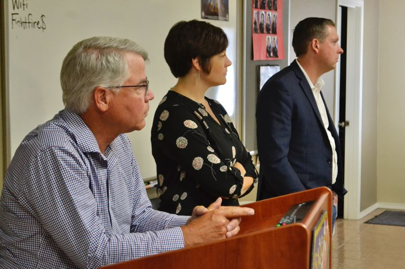 PMG PHOTO: BRITTANY ALLEN - Sen. Chuck Thomsen, Rep. Anna Williams and Mayor Stan Pulliam field questions on legislation and Sandy projects from Chamber audience at a July 24 luncheon.