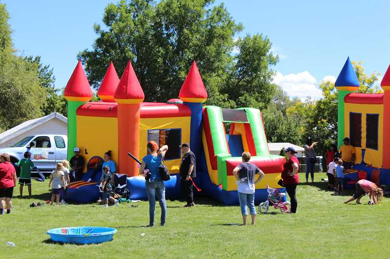 FILE PHOTO - Local kids and families enjoy fun activities at last year's Our Community event at Sahalee Park.