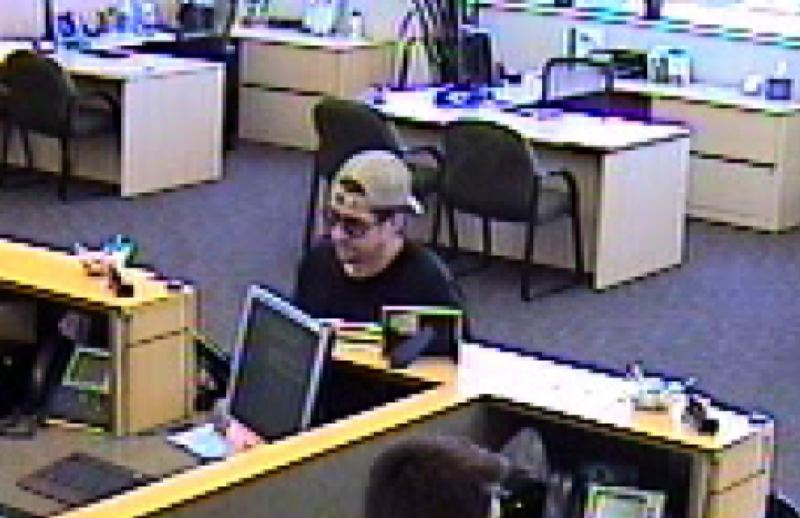 Pamplin Media Group - Police search for suspect in bank robbery