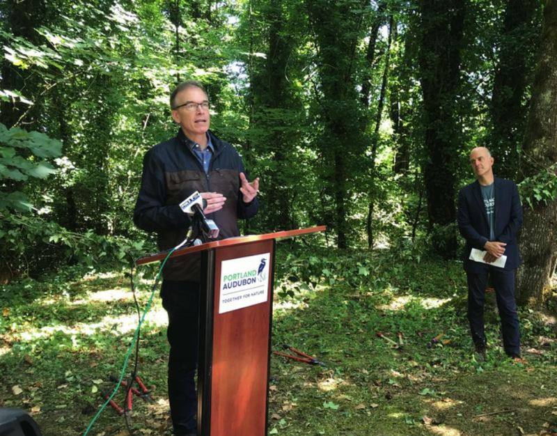 OPB PHOTO - City Commissioner Nick Fish thanks the Kehoe Family at an 'ivy-cutting' ceremony for the donation of 22 acres on July 26.