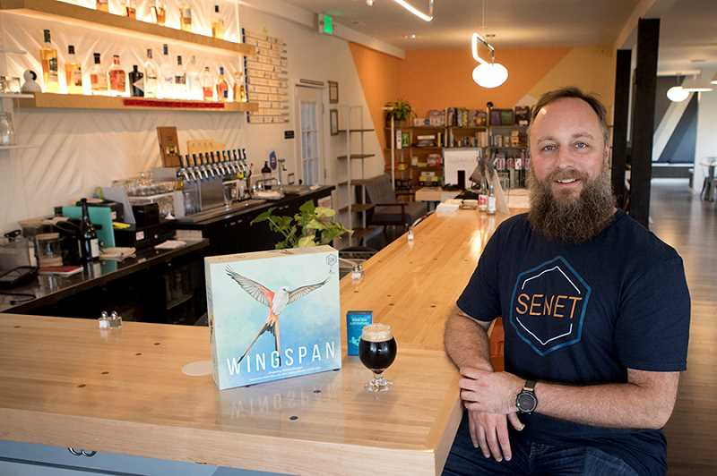 TIMES PHOTO: JAIME VALDEZ - Derrick Wright opened his Senet Game Bar in Downtown Tigard in June in the former Tigard Cycle and Ski Shop at 12553 S.W. Main St. The business offers not dozens of games but 12 taps featuring Northwest beers and ciders.