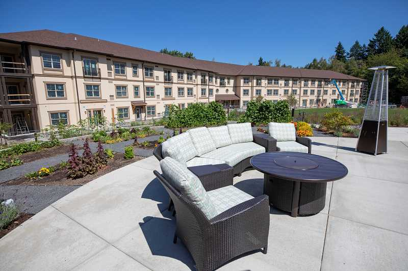 REVIEW PHOTO: JONATHAN HOUSE - The outdoor patio and garden sits amidst apartments that are just finishing construction at Marys Woods.