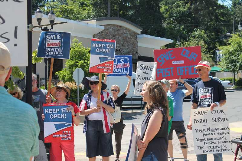 PMG PHOTO: HOLLY BARTHOLOMEW - Community members demonstrate their support for West Linns post office.