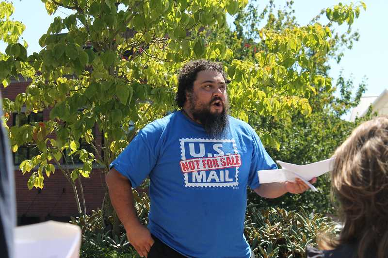 PMG PHOTO: HOLLY BARTHOLOMEW - Daniel Cortez of the American Postal Workers Union speaks at the rally.